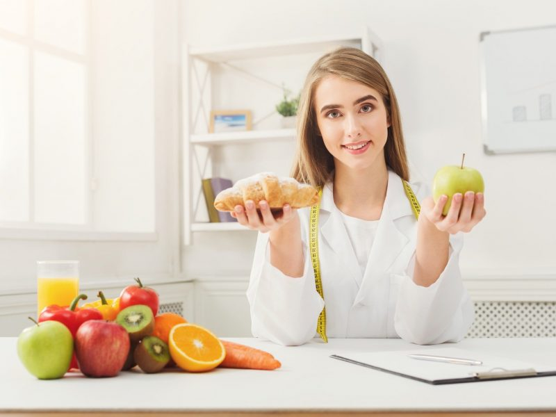 dietitian-nutritionist-with-bun-and-apple.jpg